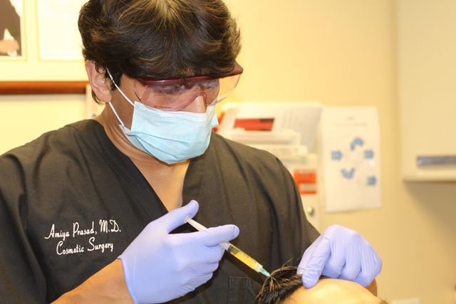 Dr. Prasad performing his TrichoStem® Hair Regeneration procedure.